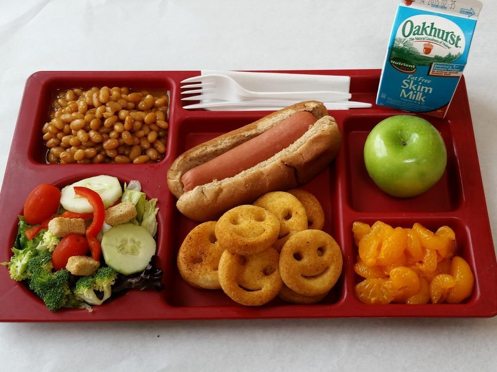 Hot Dog on a Whole Grain Bun, Baked Smile Potatoes, Salad, baked beans, Mandarin Oranges, Apple and Milk