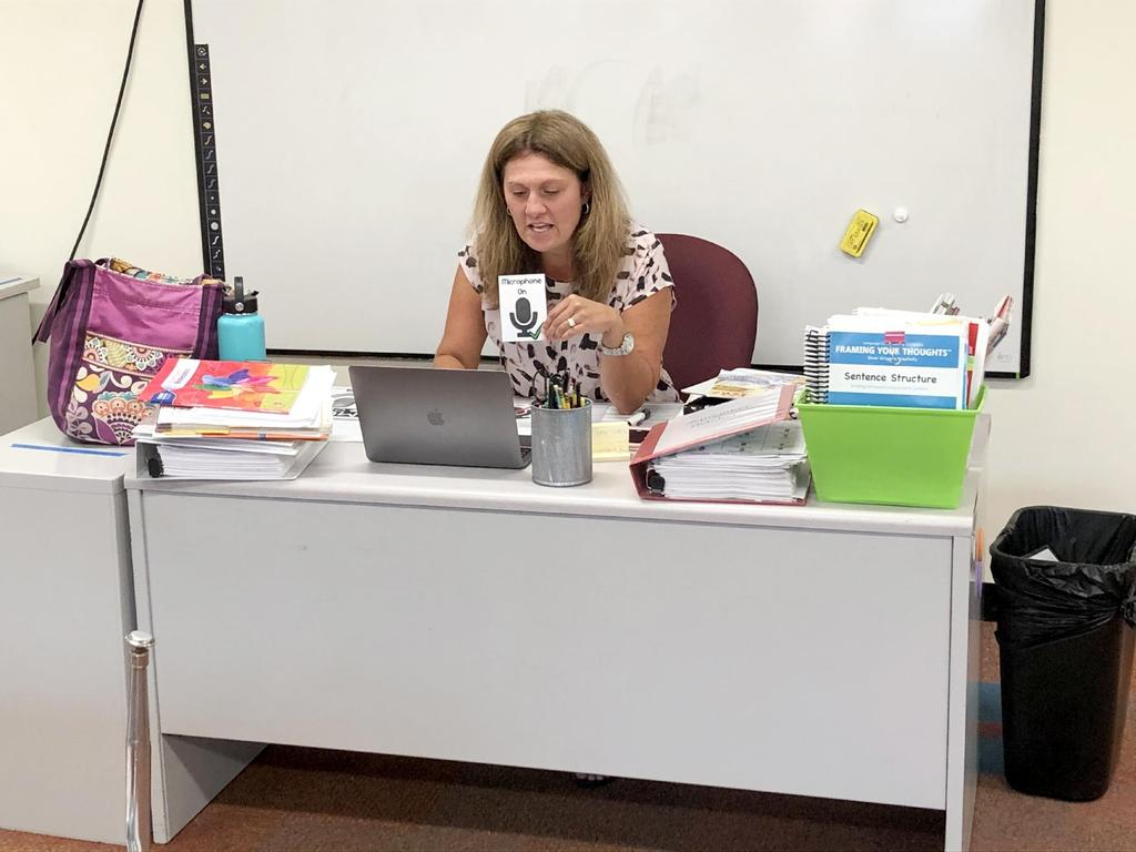 Teacher holding a flash card