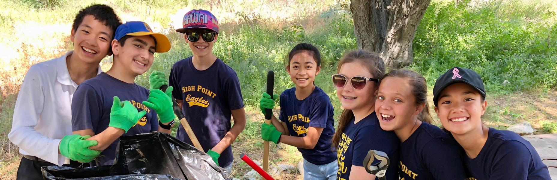 High Point Academy community engagement cleaning up trash.