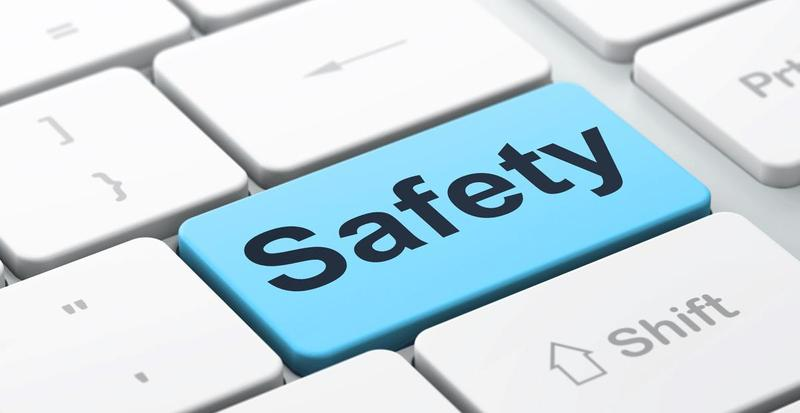 Safety button on computer keyboard
