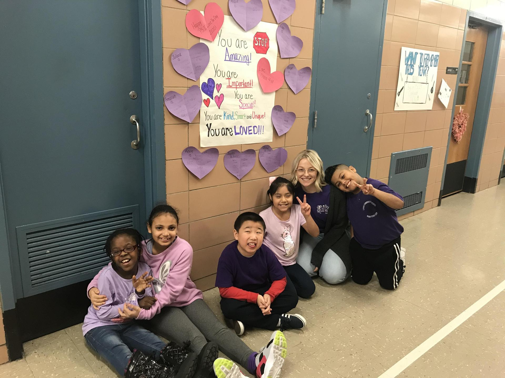 students in school hallway by messages of support for PS I Love You Day