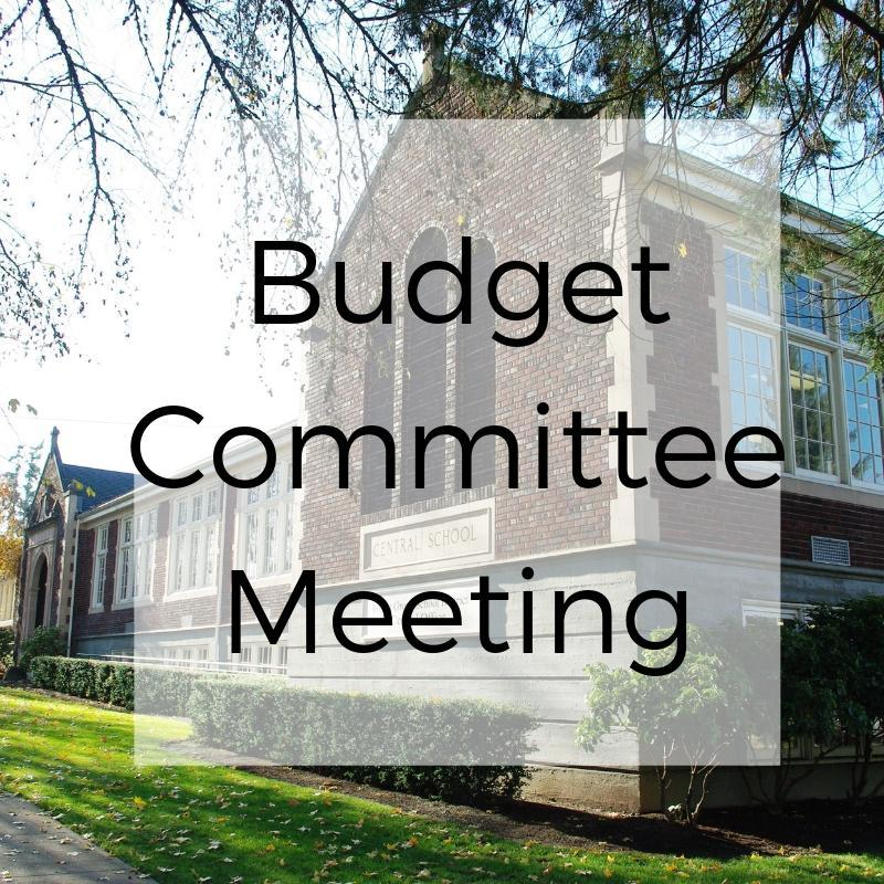 Budget Committee Meeting with a picture of the central office in the background