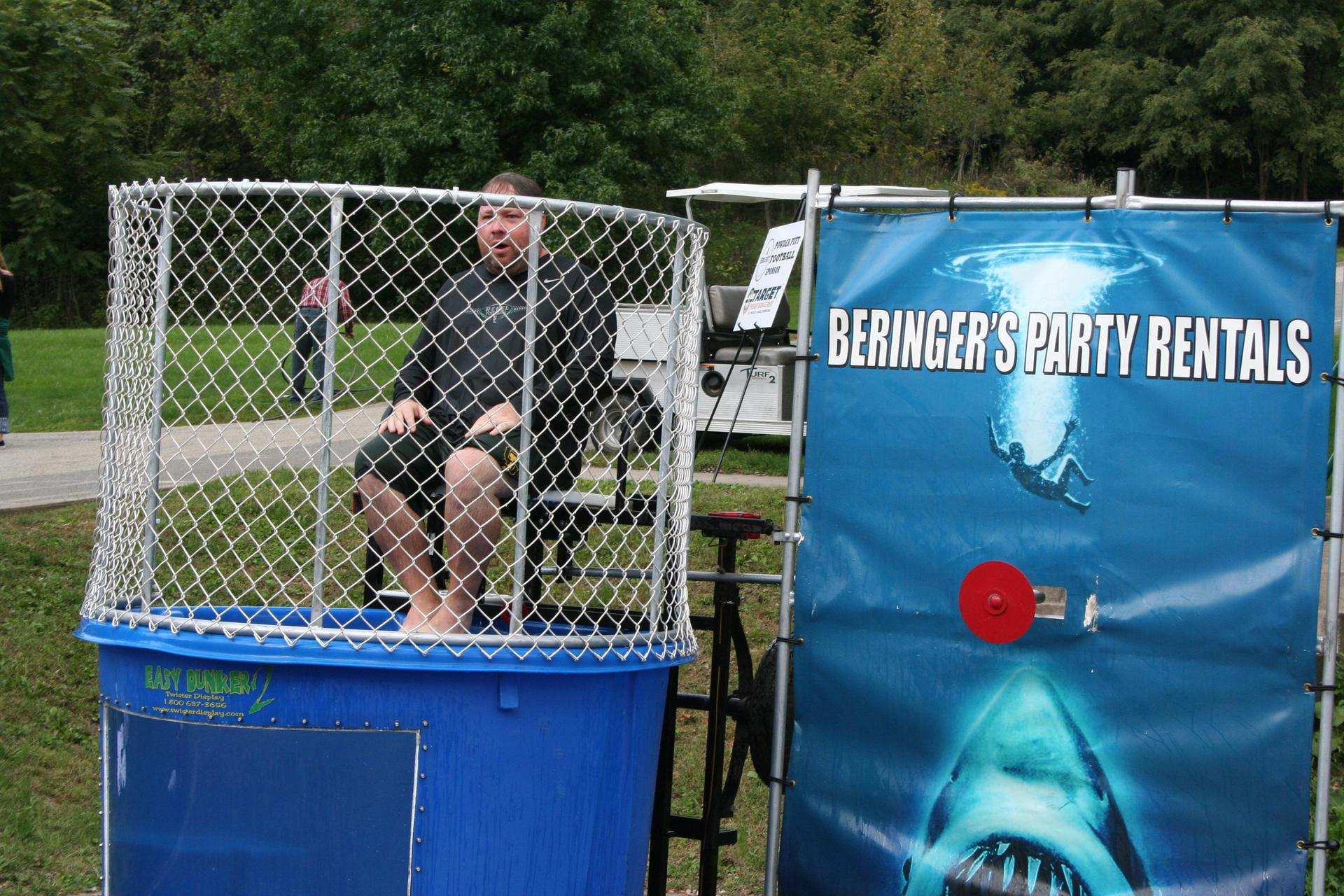 teacher sits in dunk tank
