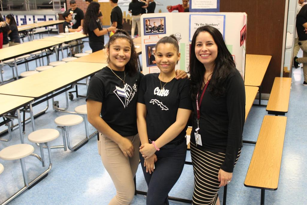 two female students with Mrs. Fernandez