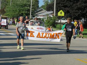 Members of the TK Alumni Association march in the parade.