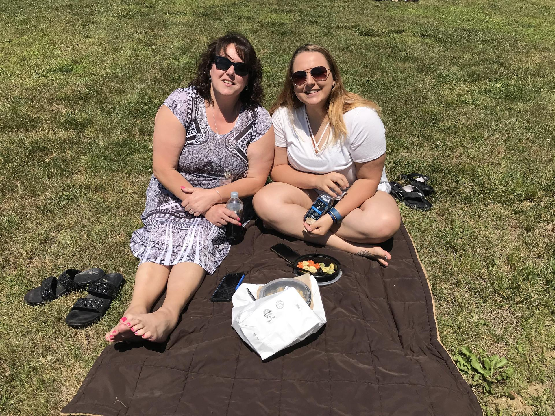 Mrs. Butkus and her daughter picnic outside.