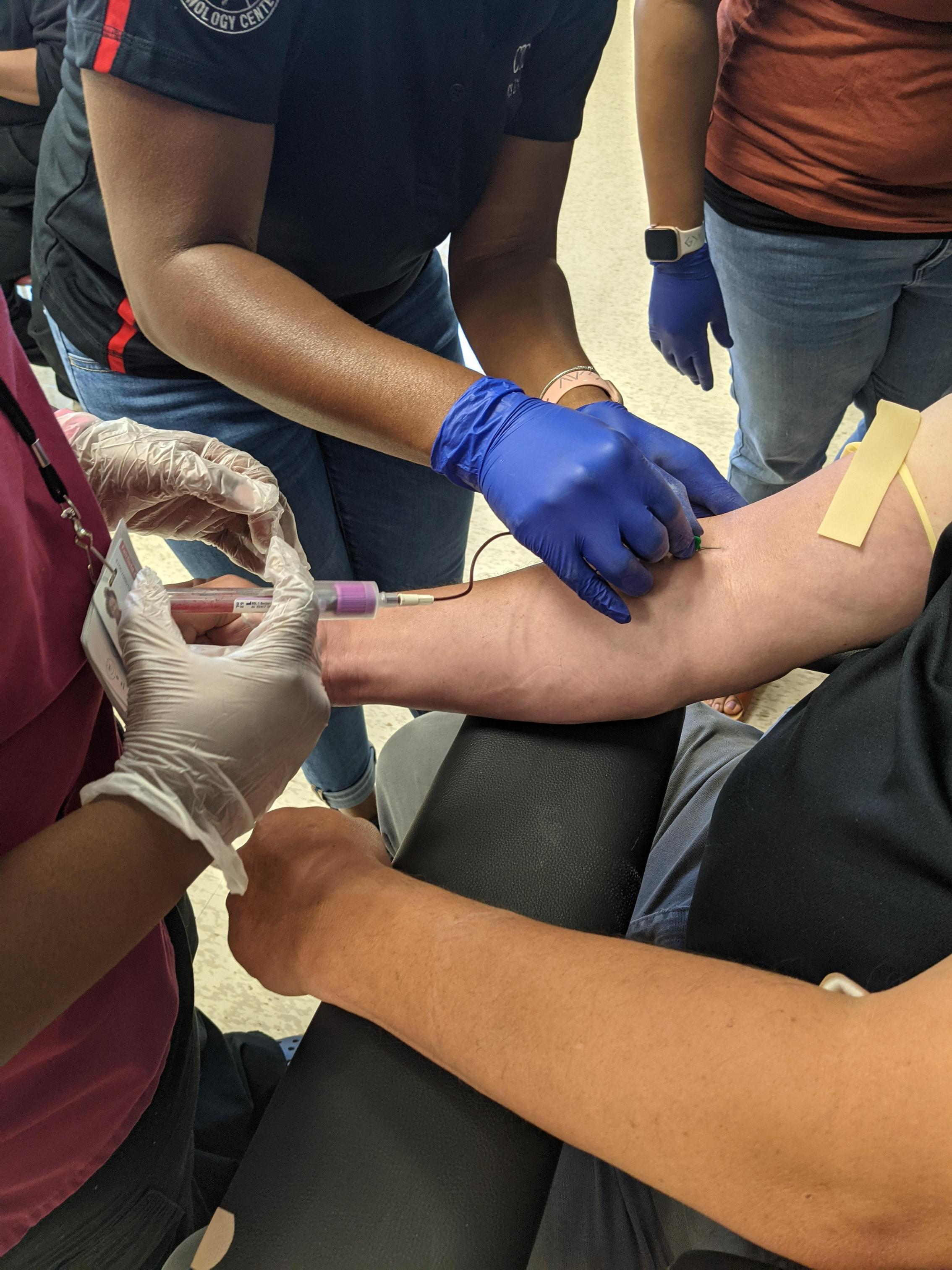 Students drawing blood.