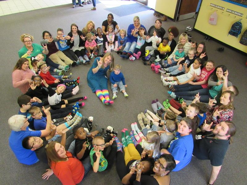 Students and staff wearing colorful socks