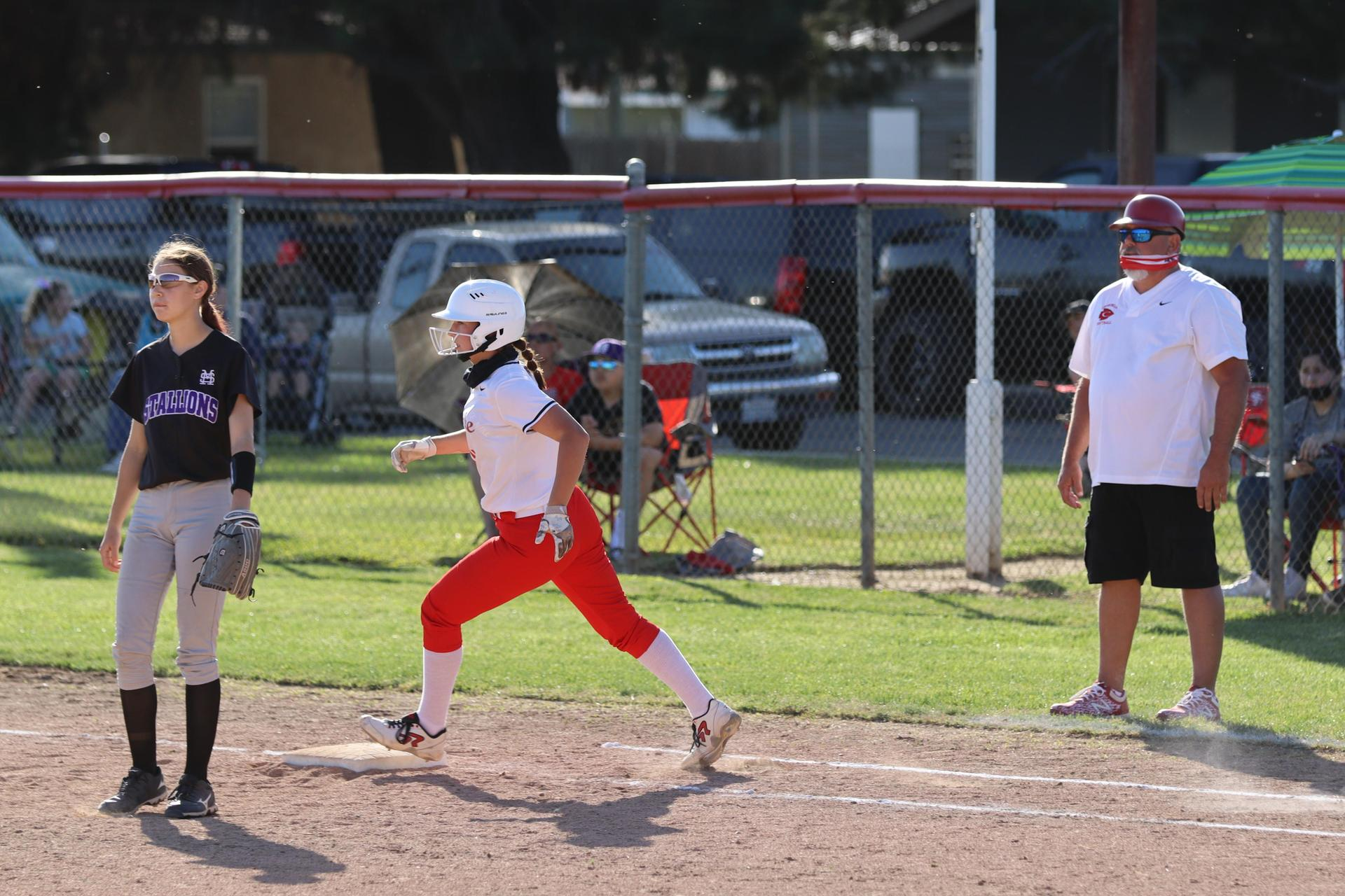 girls playing softball against Madera South