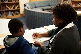 woman reading to a young scholar