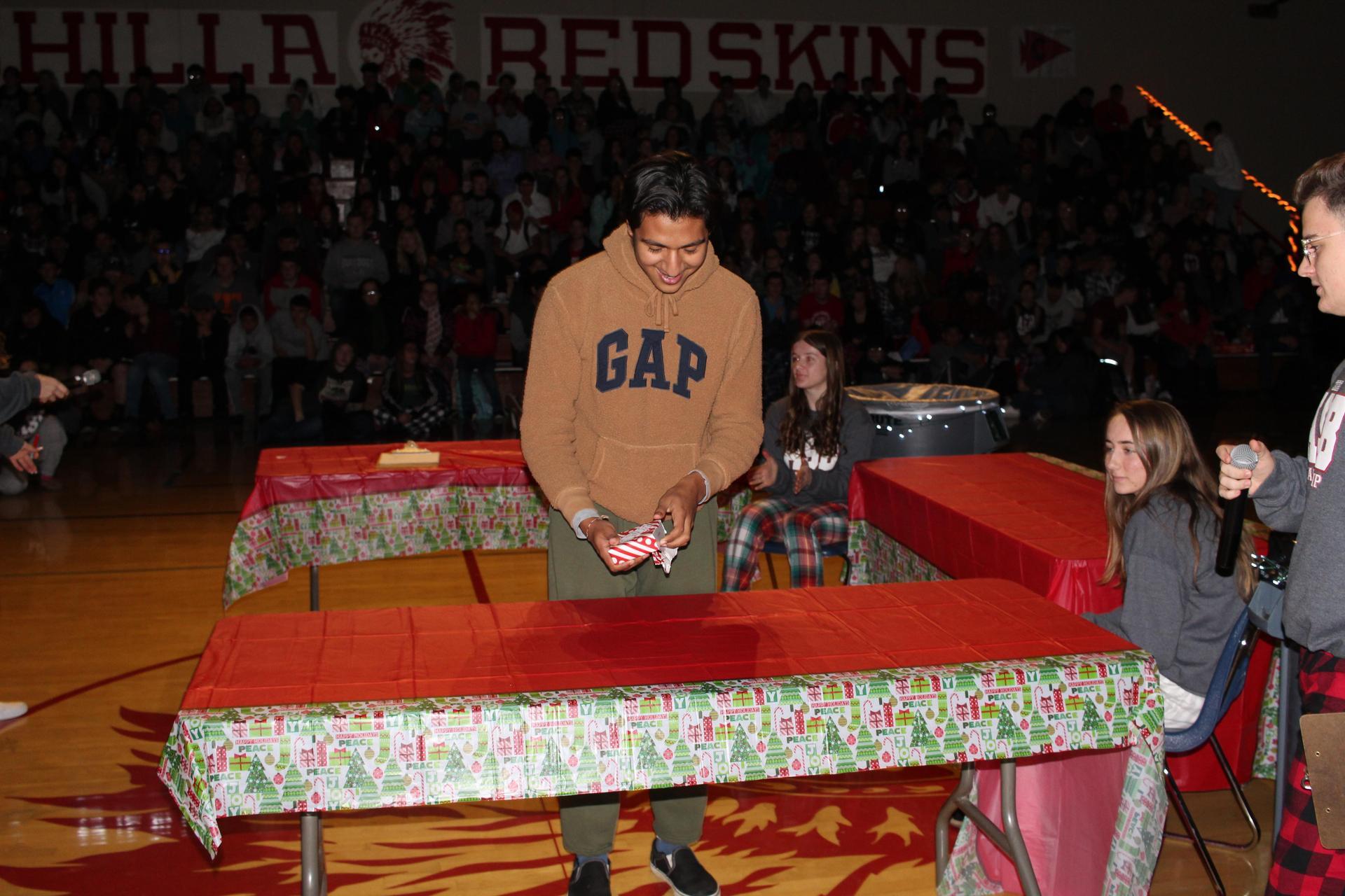 Luis Guevara opening his gift