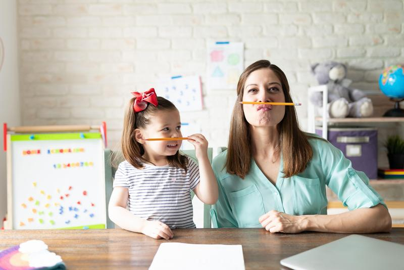 Mom and daughter with mustache pencils