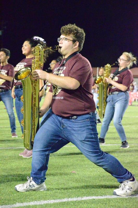 William Gutierrez plays saxophone.