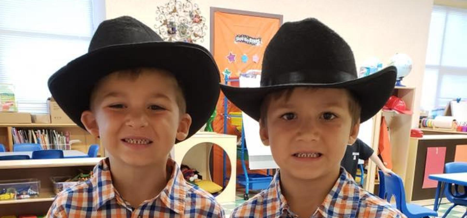 twins in cowboy hats