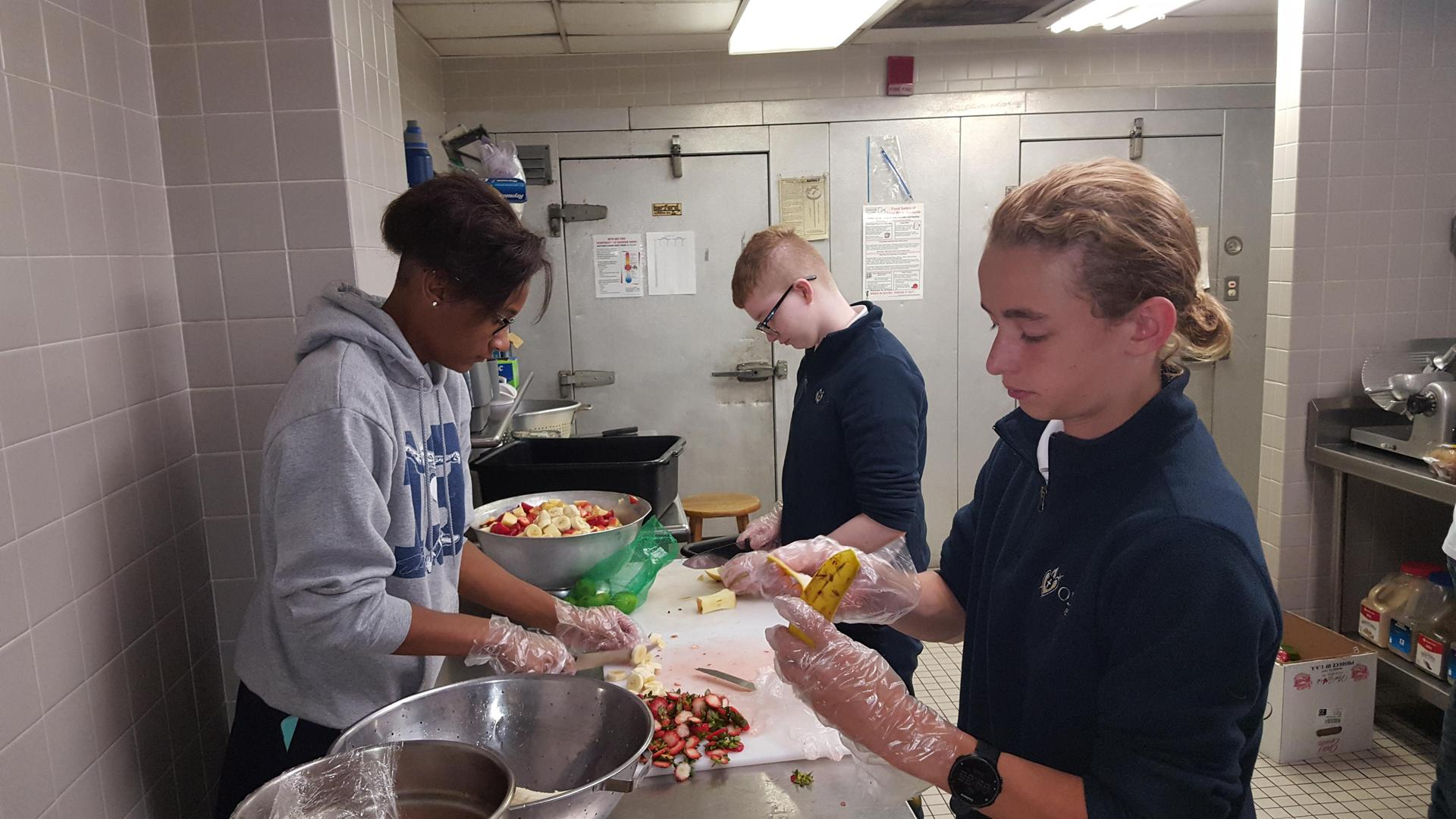 Finn volunteered at a local soup kitchen, helping to make meals for the hungry, during Mission & Heritage Week.