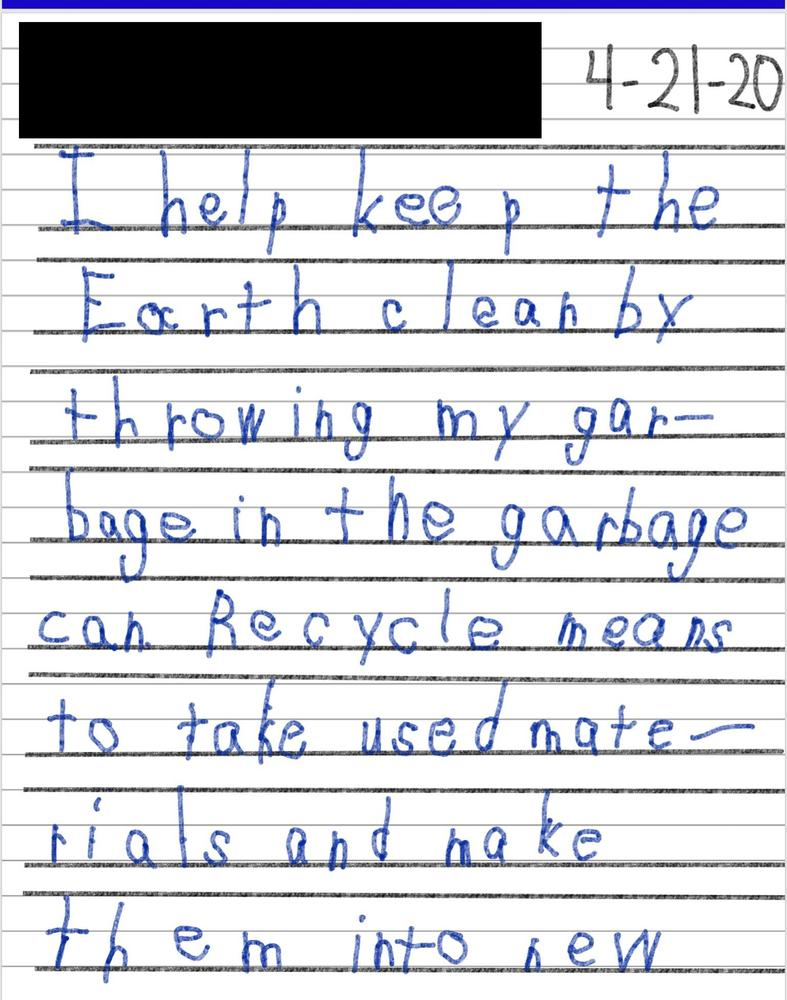 Student writing on Earth Day