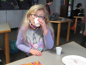 A student takes a sip of Rock & Rye Faygo pop.