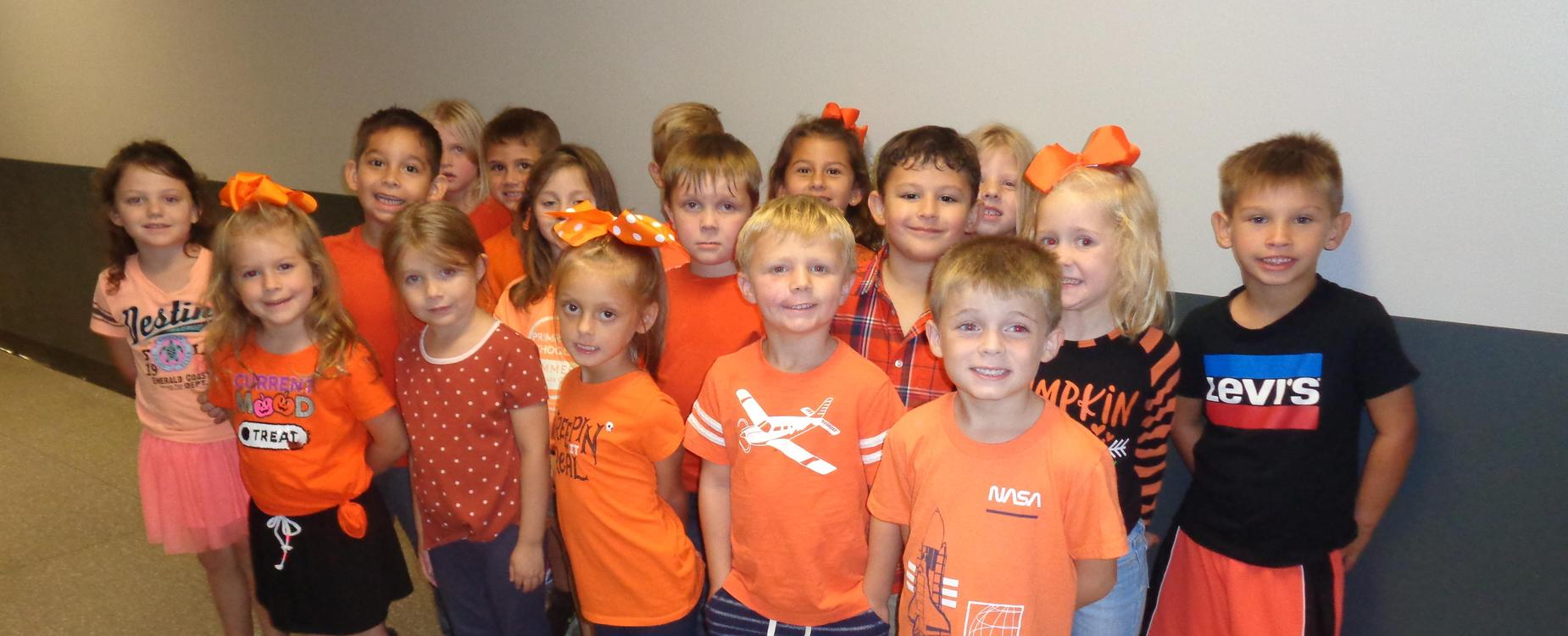 Students in orange shirts for unity