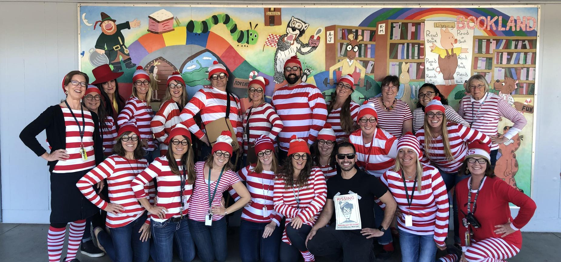 staff members dressed up for halloween as Waldo