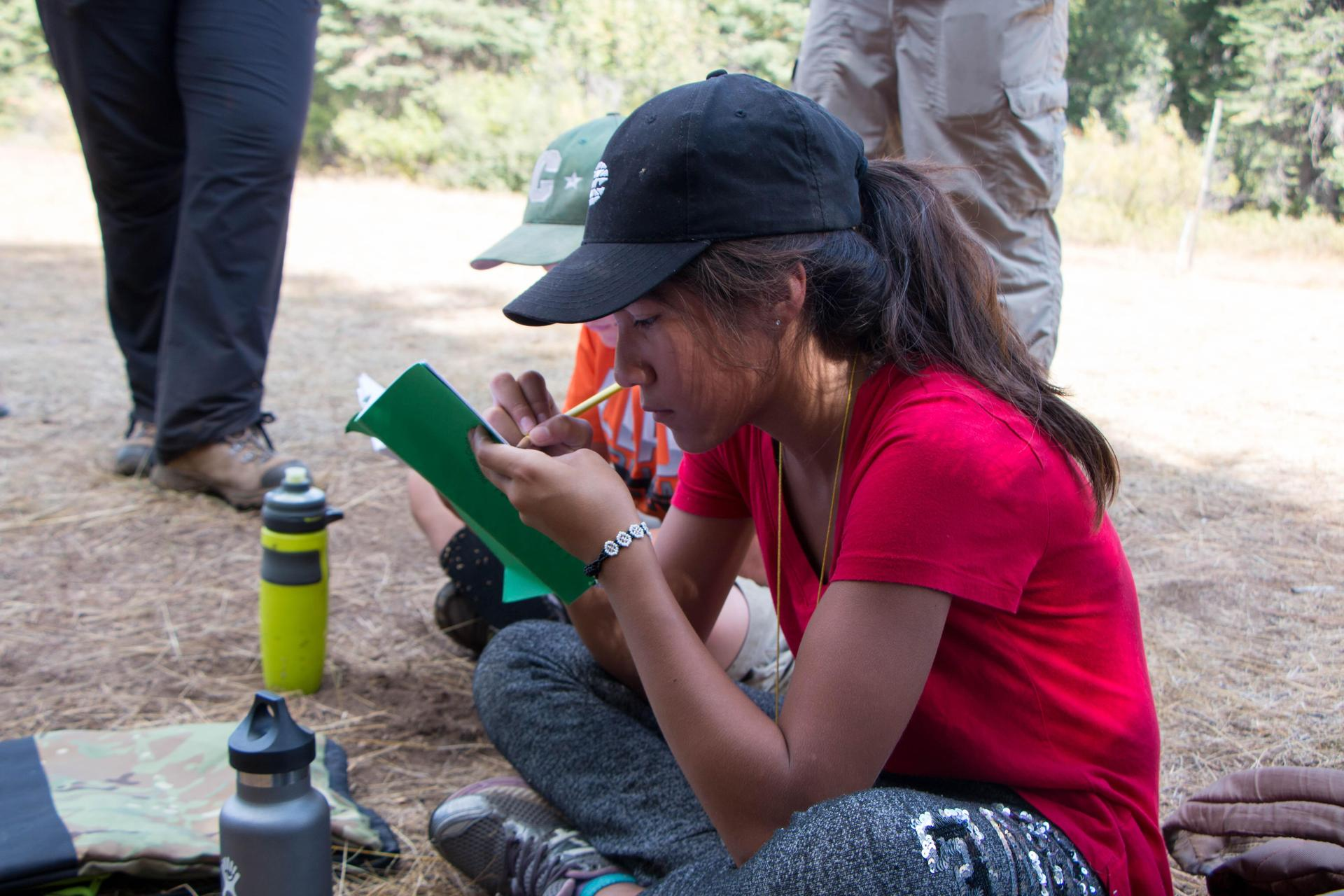 Student Writing in her Camp Journal