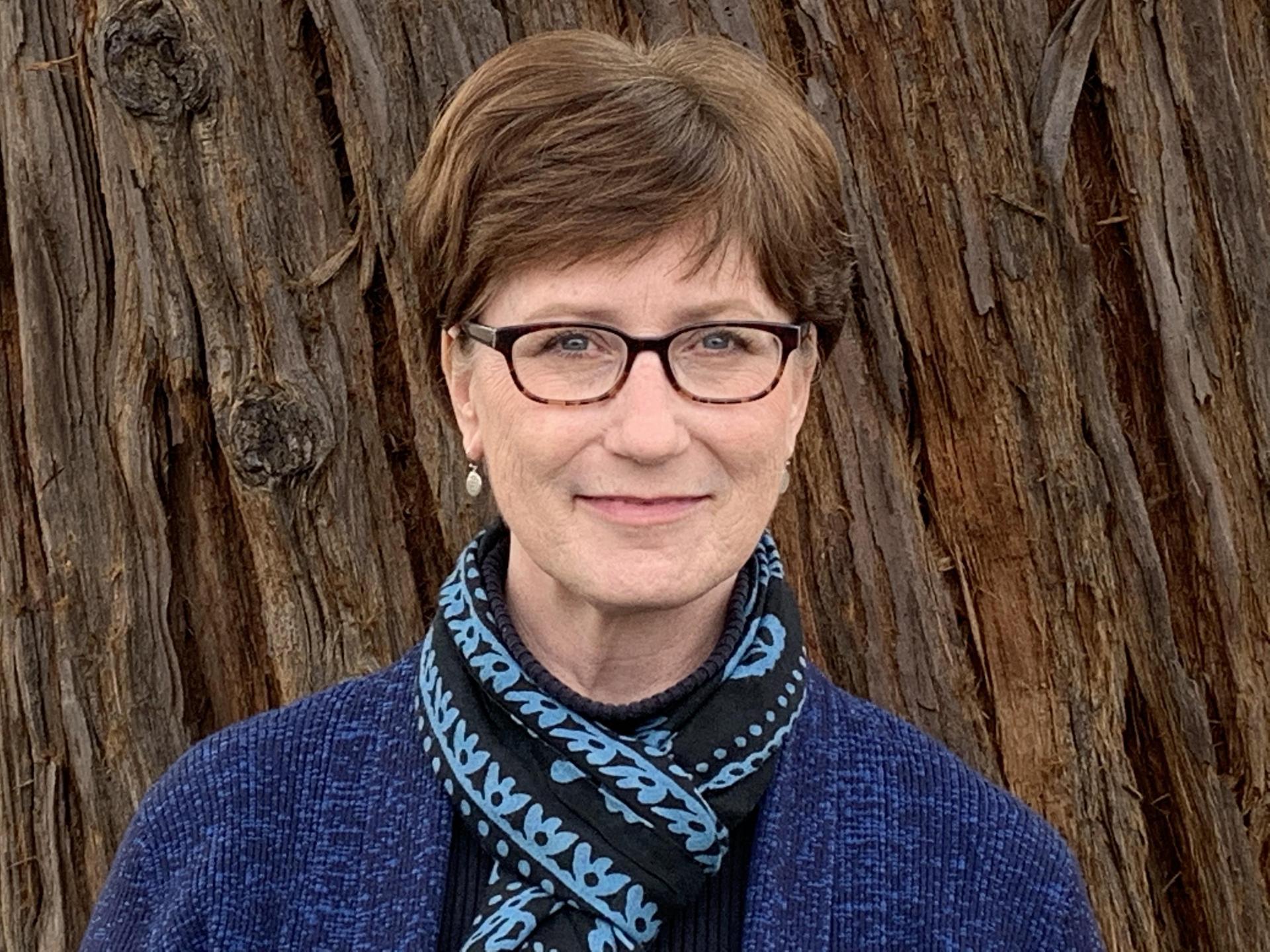 Leslie Johnson-Tatsuta Assistant Director