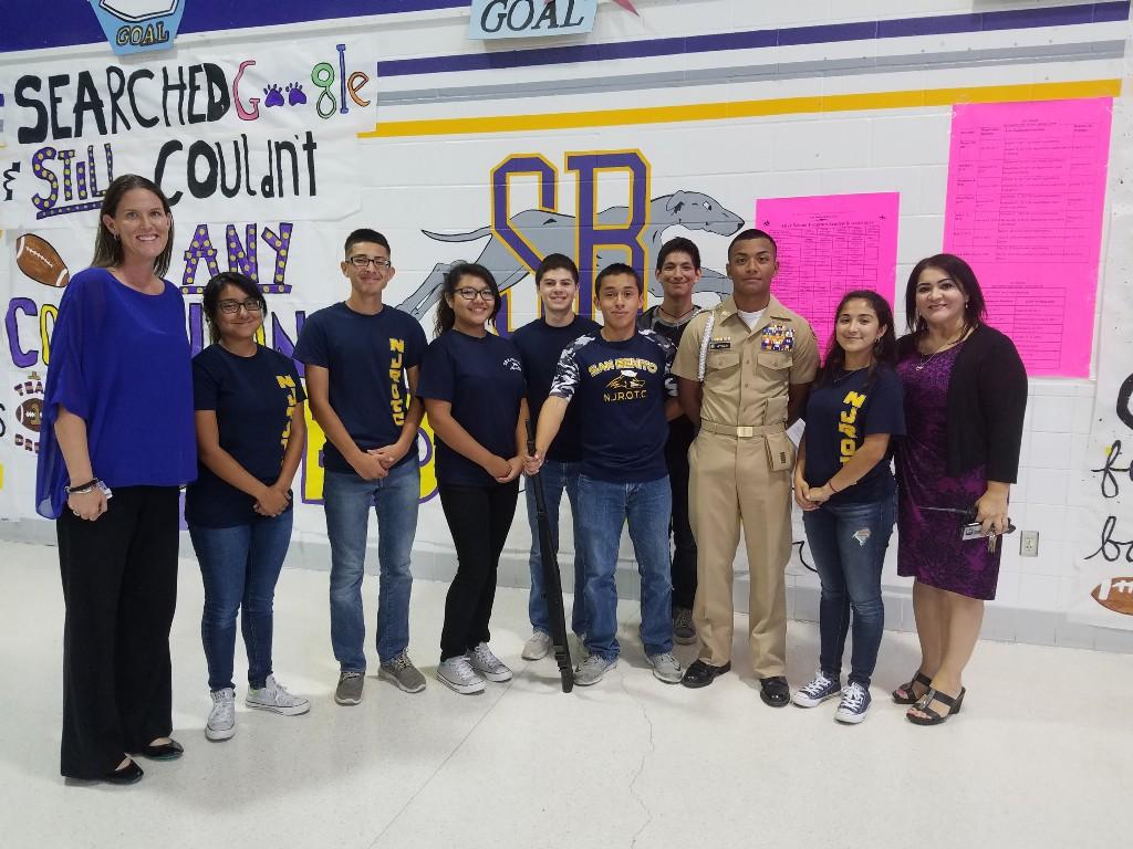 Mrs. Hollon and Ms. Fernandez posing with ROTC students.
