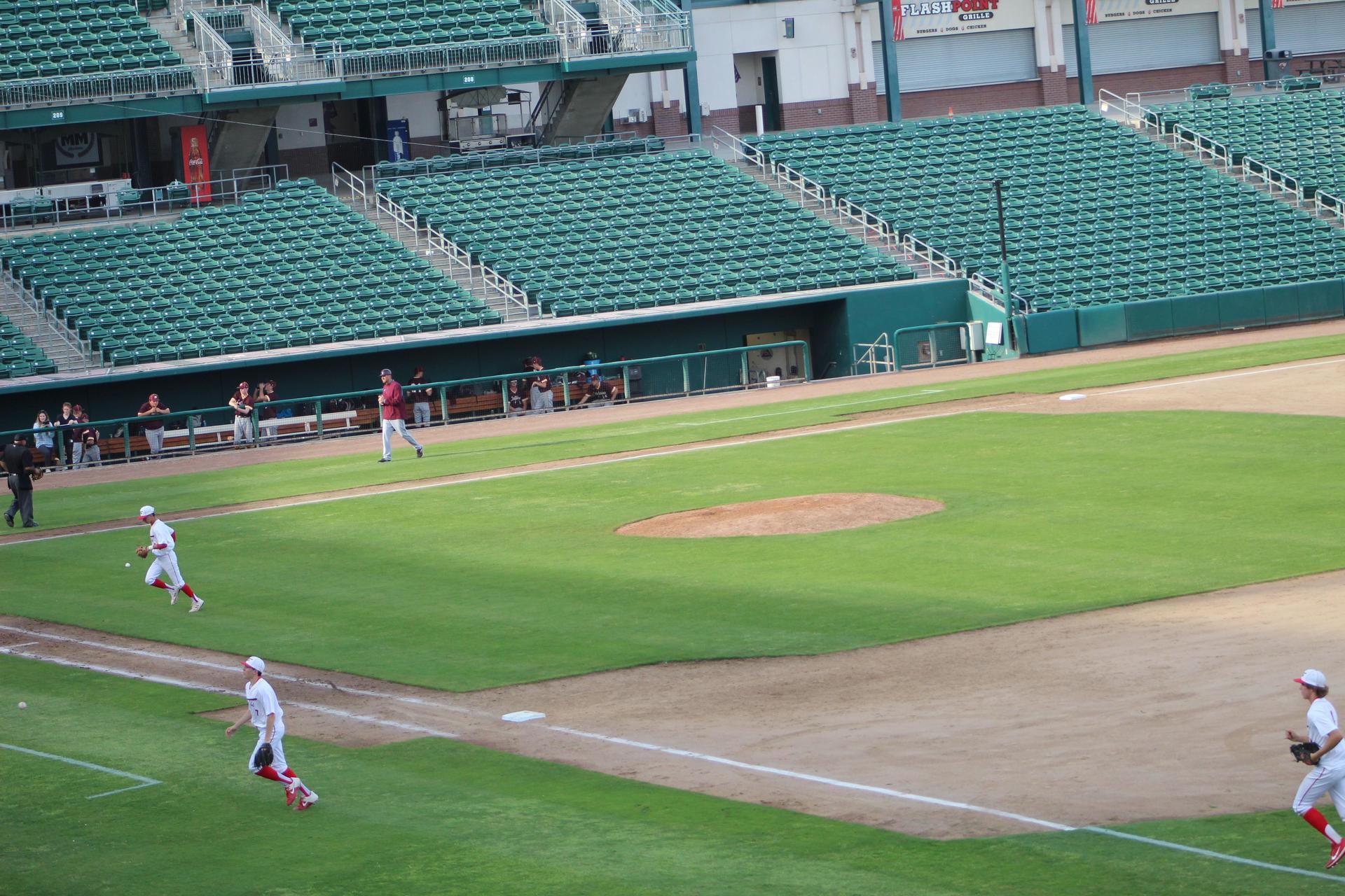 varsity baseball playing against Sierra at Chukchansi Park