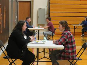TKHS seniors practice their job interview skills with volunteer company representatives.
