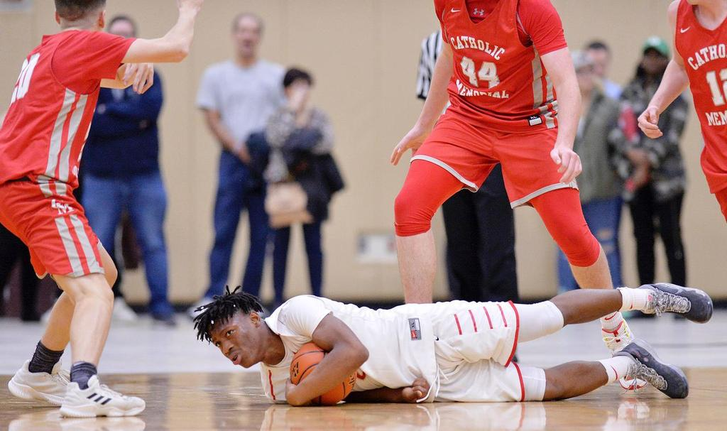 An EHS player, flat on the ground, corrals a loose ball