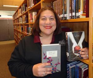 Margie Longoria holding two books