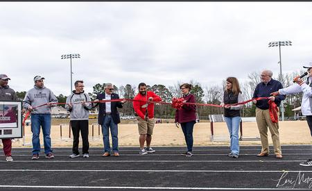 ribbon cutting at track
