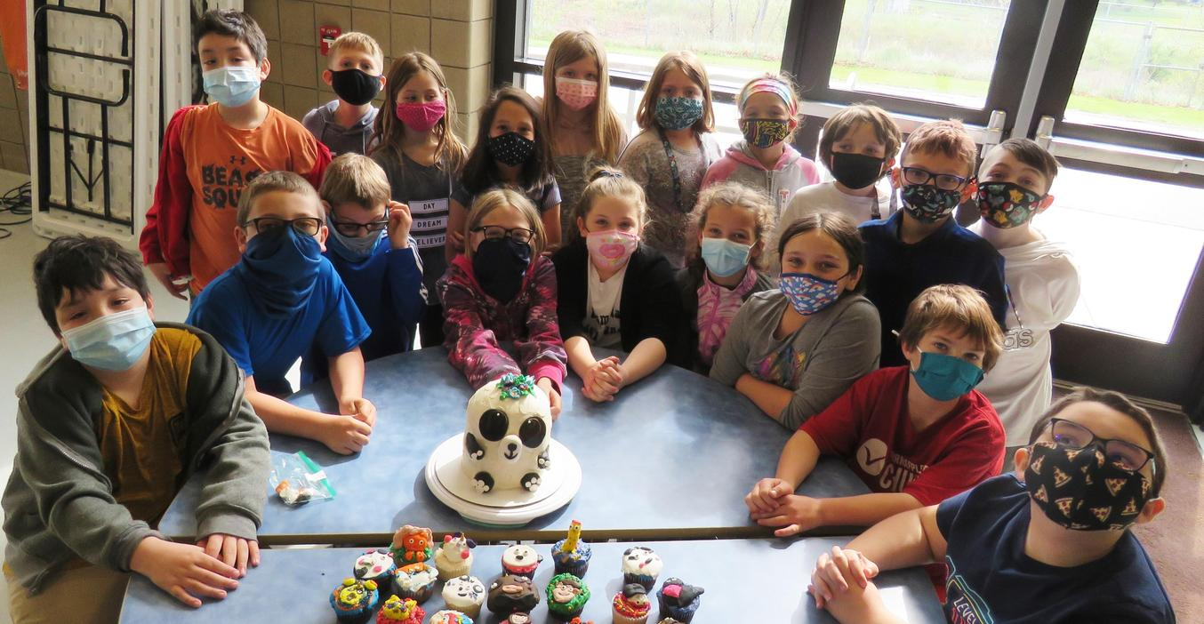 A class of Lee third graders show their uniquely decorated cupcakes and cake.