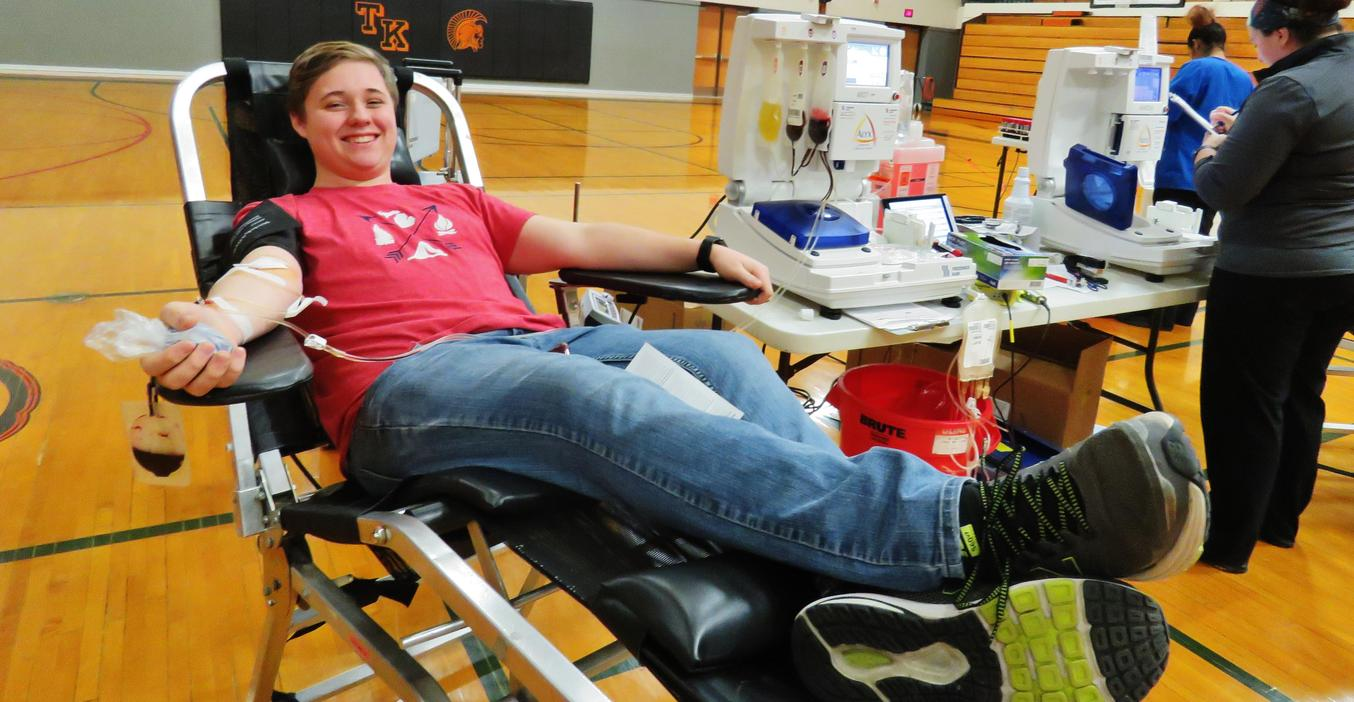 A TKHS student gives blood during a blood drive at school.