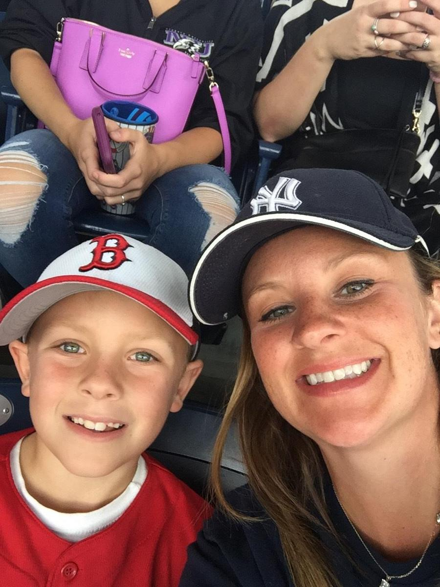 Mrs. butkevich and son at a baseball game