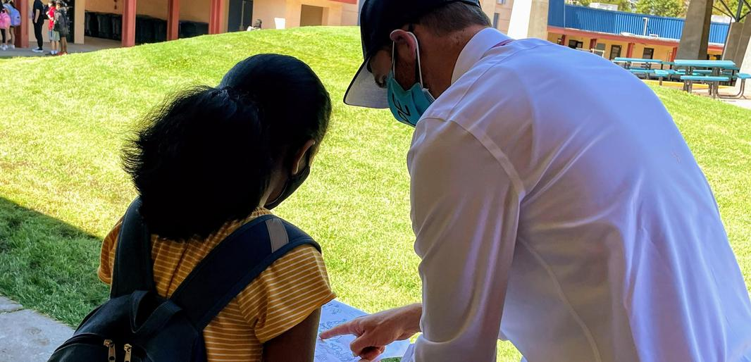 Harvest Park Middle School Principal Russell Campisi helps a student find her way to class
