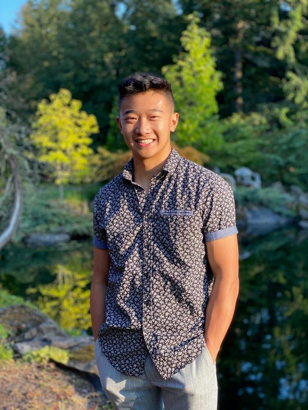 teen standing outside in dress shirt and slacks