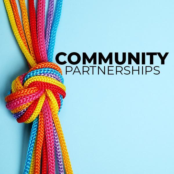Colorful interlocking pieces of string, connoting partnerships