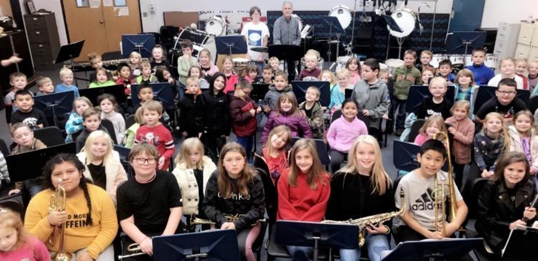 Kids learn music from Belmont Band members