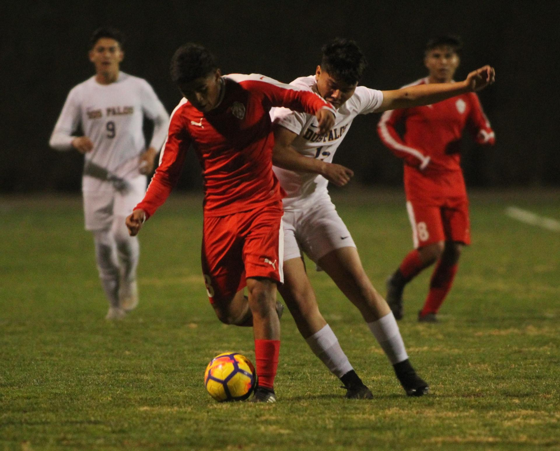 two chowchilla players fighting for the ball