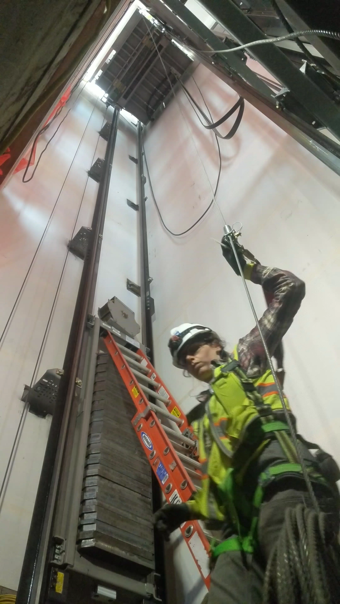 human working on elevator