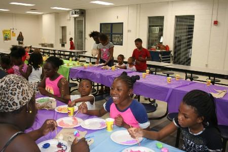 Students painting rocks for Tifton Rocks.