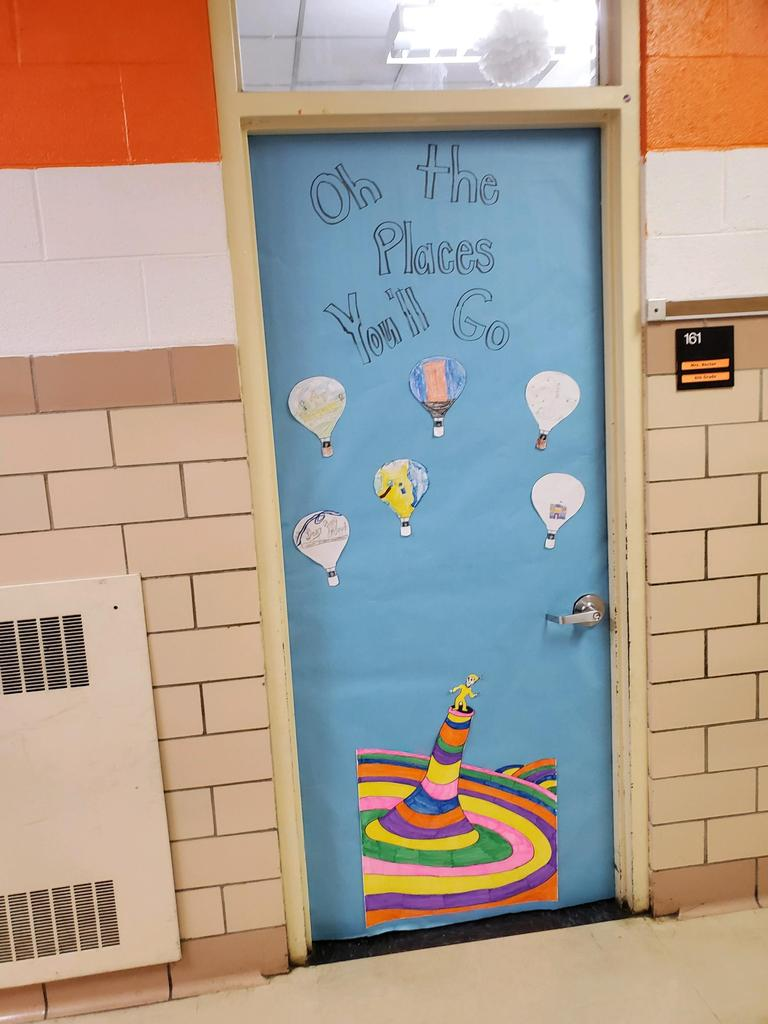 "Door decorated as ""Oh the Places You'll Go"""