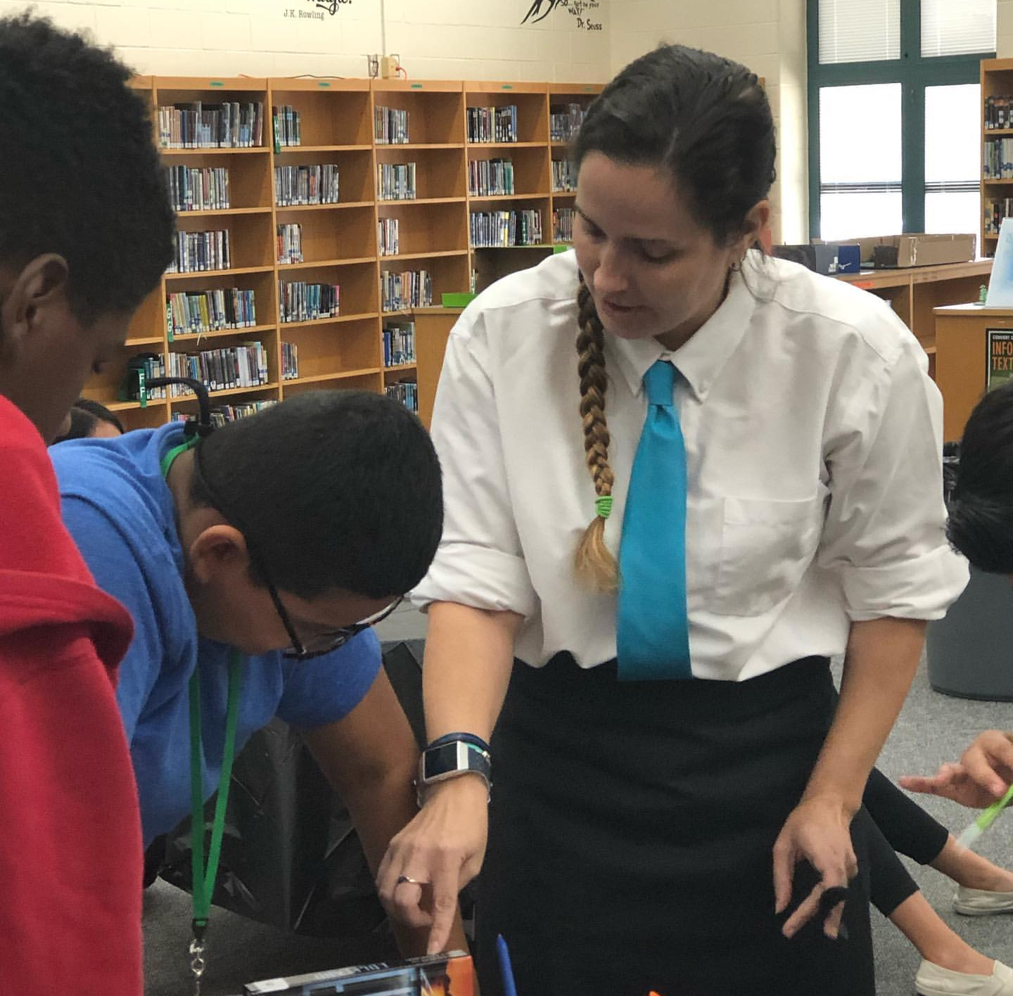 Ms. Breedlove helping some students during the book tasting
