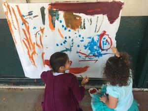 Students painting picture