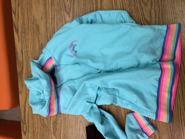 light blue jacket with rainbow detail