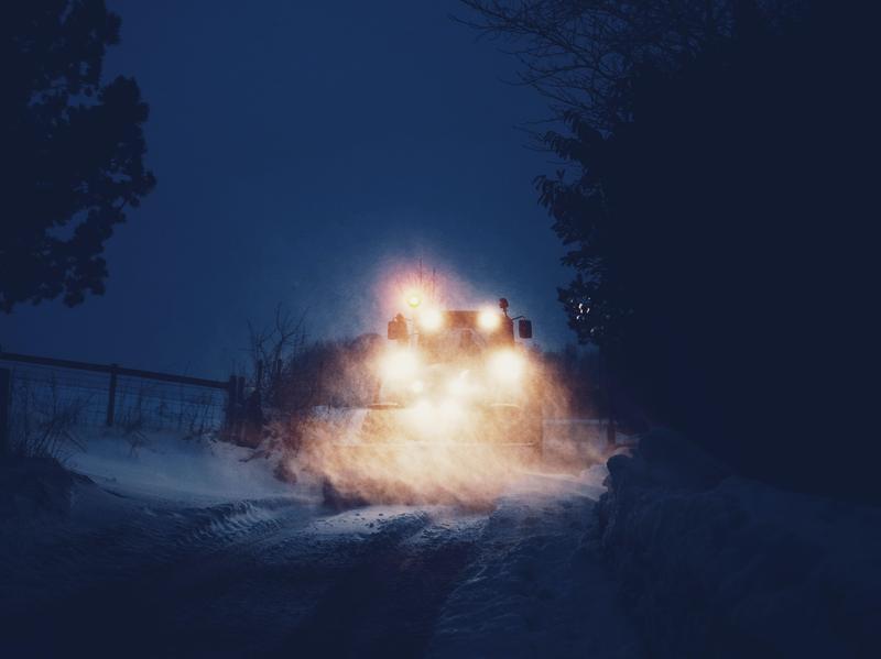 Snow plow at night