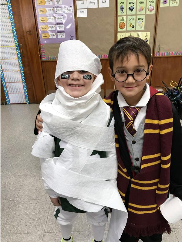 A mummy and Harry Potter at Washington School as the students celebrated Halloween with a parade and parties.