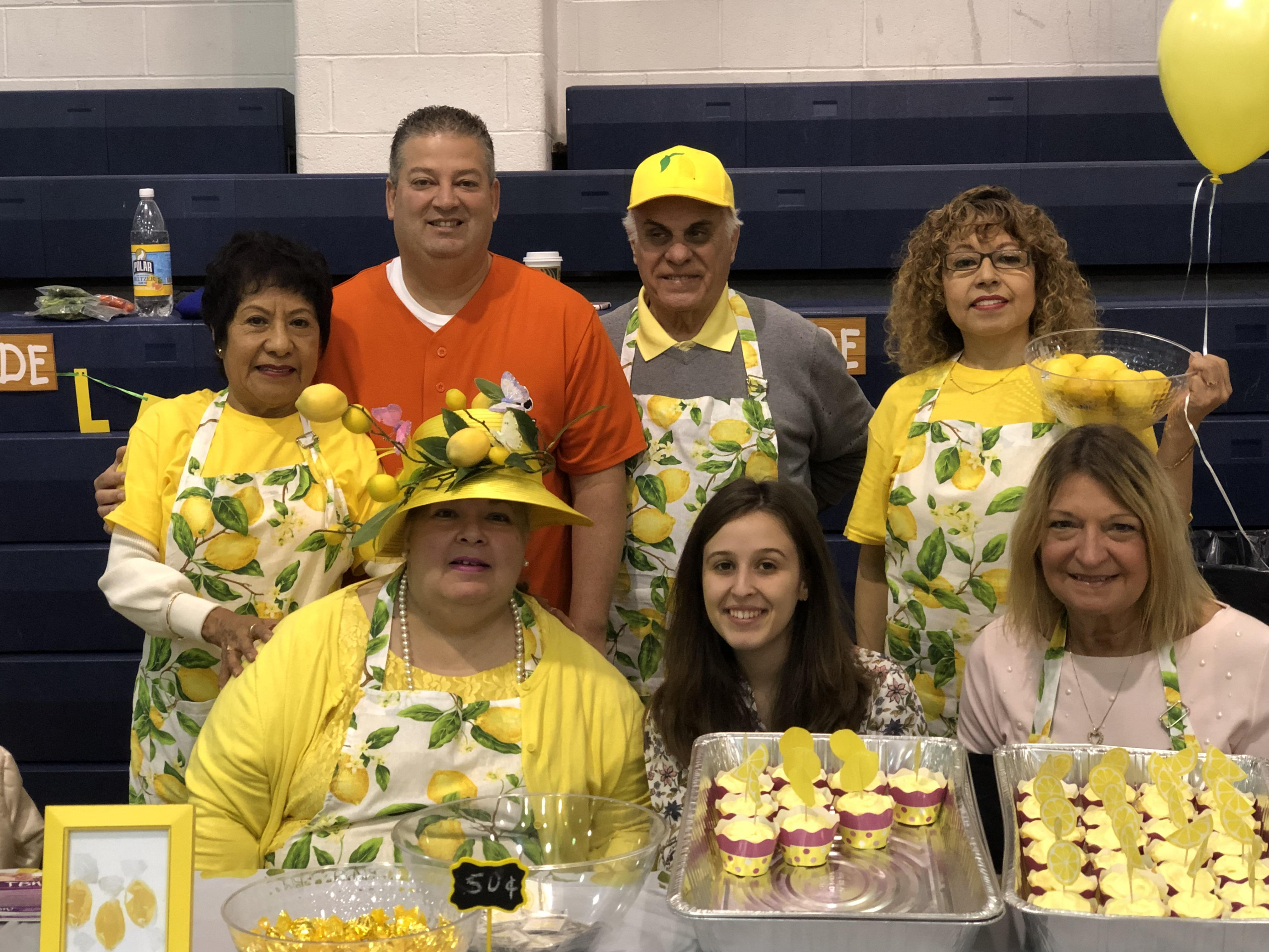 Mr. Rivera with Washington Staff at the table with fresh lemonade and lemon cupcakes