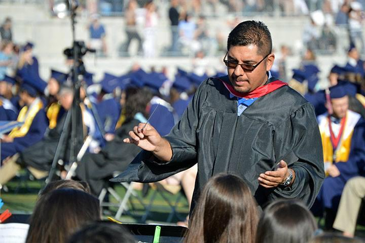 Mr Garcia leads the band during graduation