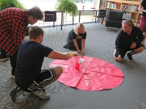 TKHS physics students work together to solve the toxic spill challenge.